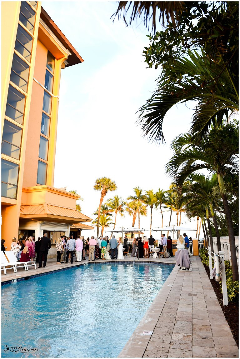 When you want a tropical wedding, look no further than sunny Florida! And this tropical wedding at the Wyndham Deerfield Beach Resort sets the bar high, with its sweetheart table lined with pineapple palm trees and every table decked out in pineapples and birds of paradise!