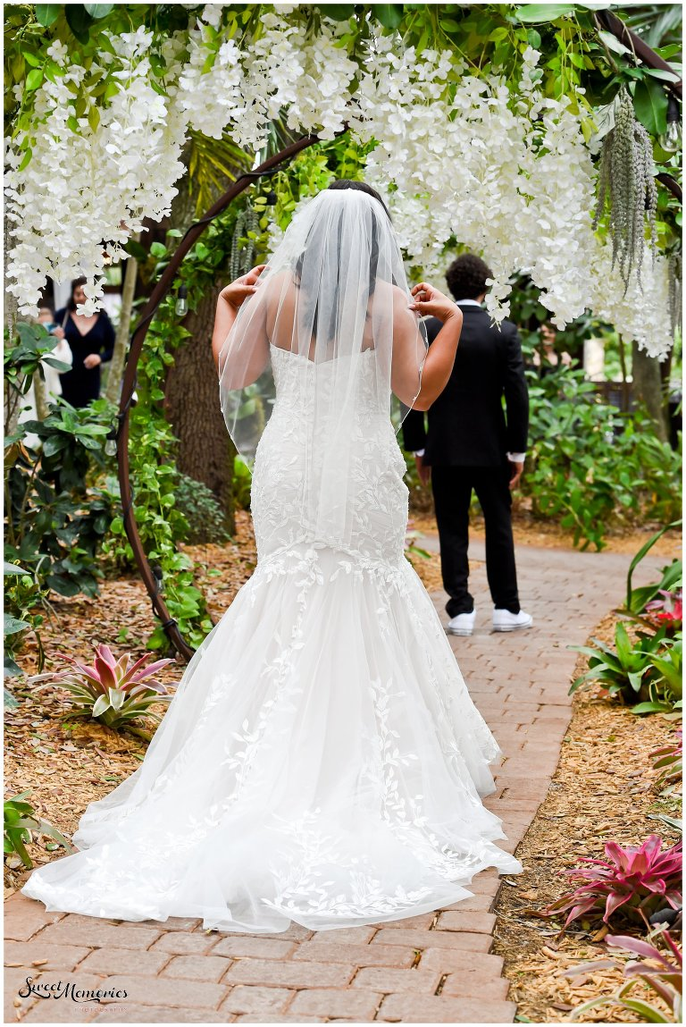 Tropical yet classic, Janice and Michael's Living Sculpture Sanctuary wedding in Davie was the perfect mix of romantic, hilarious, fun, sweet, and chic! After having met at a restaurant, his persistence, and a romantic proposal at the Flamingo gardens, they are now ready to tie the knot!